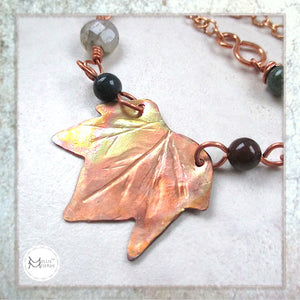 Hand forged copper maple leaf centerpiece in gemstone beaded adjustable length chain, jewelry designed and handmade by Mollie Meserve for Rough Magic Creations