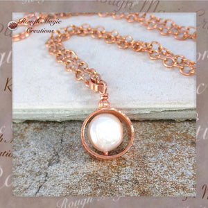 Handmade pearl drop and copper pendant on chain necklace, influenced by abstract, minimalist, modern, avant garde and non-traditional styles.