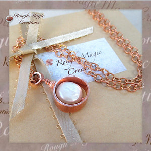 Handmade solid copper and real pearl pendant on chain necklace, shown as shipped with Rough Magic Creations jewelry presentation box.