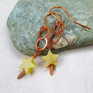 Celestial Star Earrings, Olive Green Serpentine stones aka new jade, olive jade - semi precious gemstones, rustic copper wires and components, boho stellar cosmic statement jewelry for women, handcrafted by Mollie Meserve Designs for Rough Magic Creations handmade jewelry.