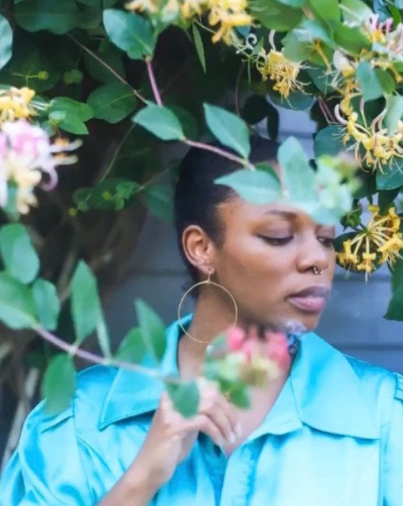 beautiful Black woman in handmade hoops standing behind the honeysuckle. earrings are the perfect gift for any woman or person with pierced ears. Great holiday gift ideas. Can be matched with other jewelry for gift baskets.