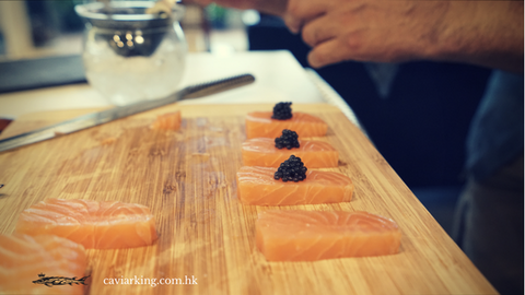 Open a jar of Beluga Caviar, and use the Mother-of-Pearl spoon to put the caviar in the middle of each salmon sashimi | Salmon Sashimi with Caviar | Recipe by Caviar King