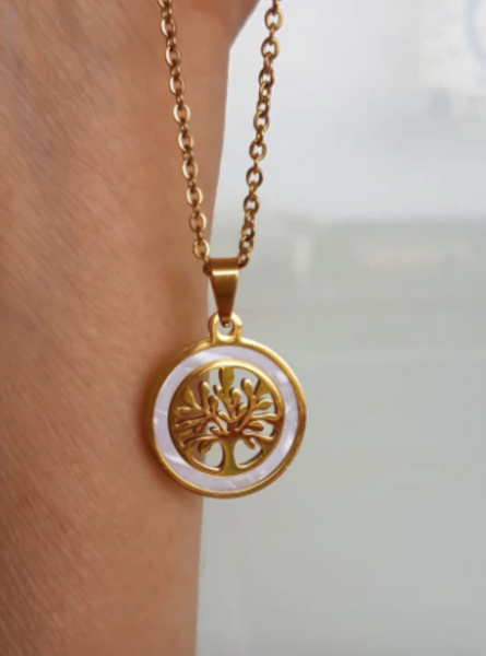 Our Tree Of Life White Shell and 316L Stainless Steel pendant necklace is the perfect high vibe addition to any outfit. Delicate and classy, this positive necklace ships FREE for a limited time at New World Living.