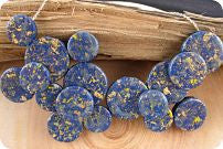 A blue, flecked with gold statement...Lapis... I wonder???