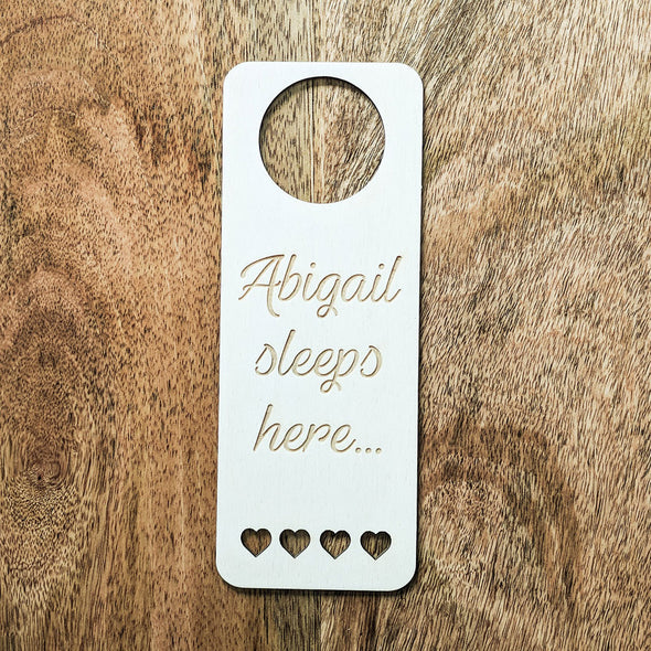 Personalised Wooden Sleeps Here Door Hanger
