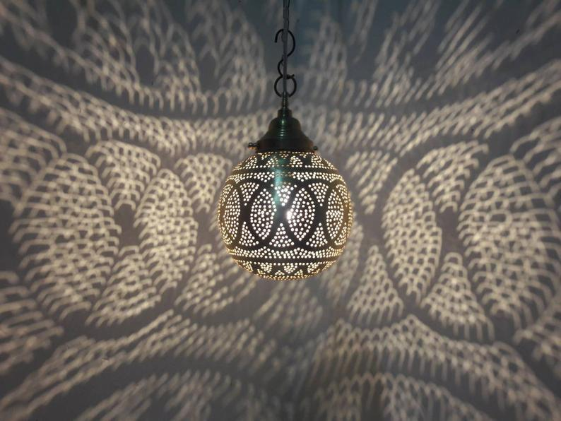 This Spherical Small ceiling light fixture is a versatile piece as it hangs well either in a hallway or living room amongst others. The hand