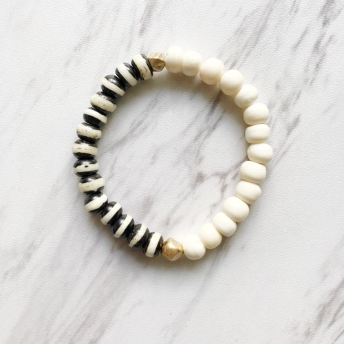 Stripes and gold bracelet