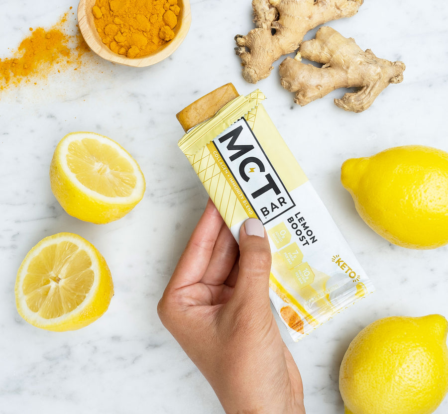 hand holding lemon boost mctbar keto collagen snack bar