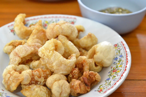 Pork rinds on a white plate