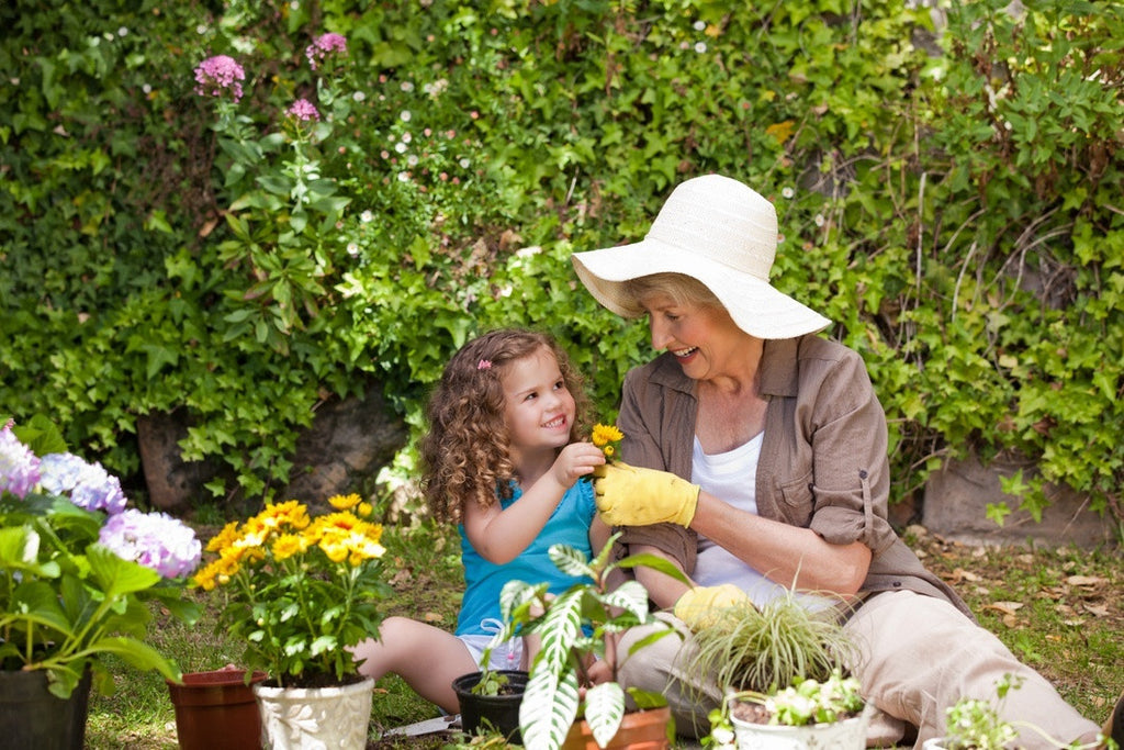 GrowUp Vertical Farming | grandmother and granddaughter gardening