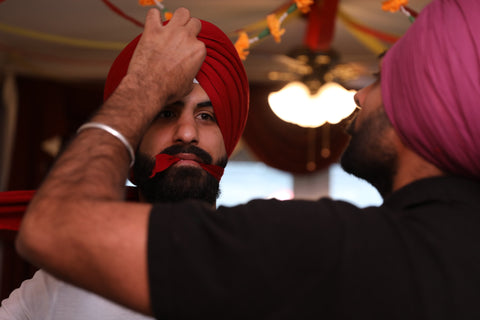 Securing the turban with a pin