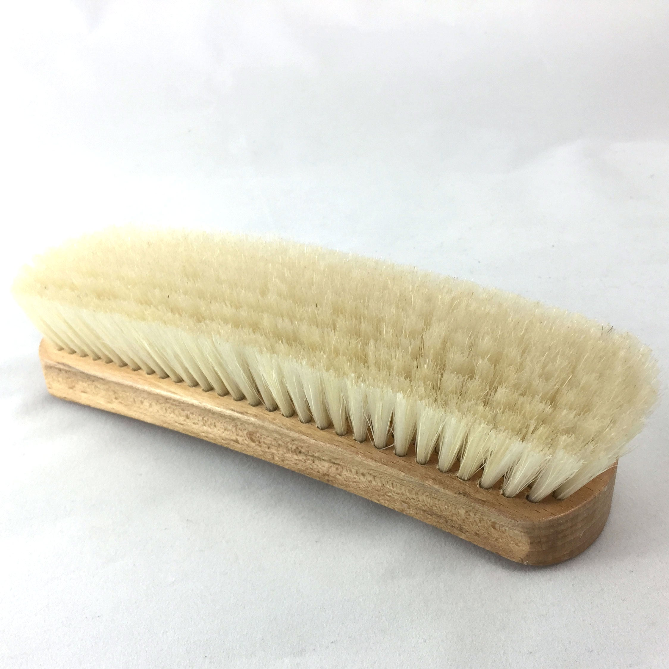 Showing bottom and side of horsehair and oak clothing and shoe brush. Best use for lint, pet hair and buffing shoes.
