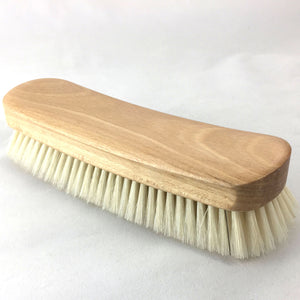 Showing top and side of horsehair and oak clothing and shoe brush. Best use for lint, pet hair and buffing shoes.