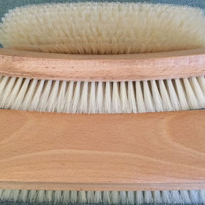 Clothing and shoe brushHorsehair and oak clothing and shoe brush showing  the bottom and side, best for lint, pet hair and buffing shoes close up of 3 pieces, showing top, side and bottom. Best for lint, pet hair and buffing shoes