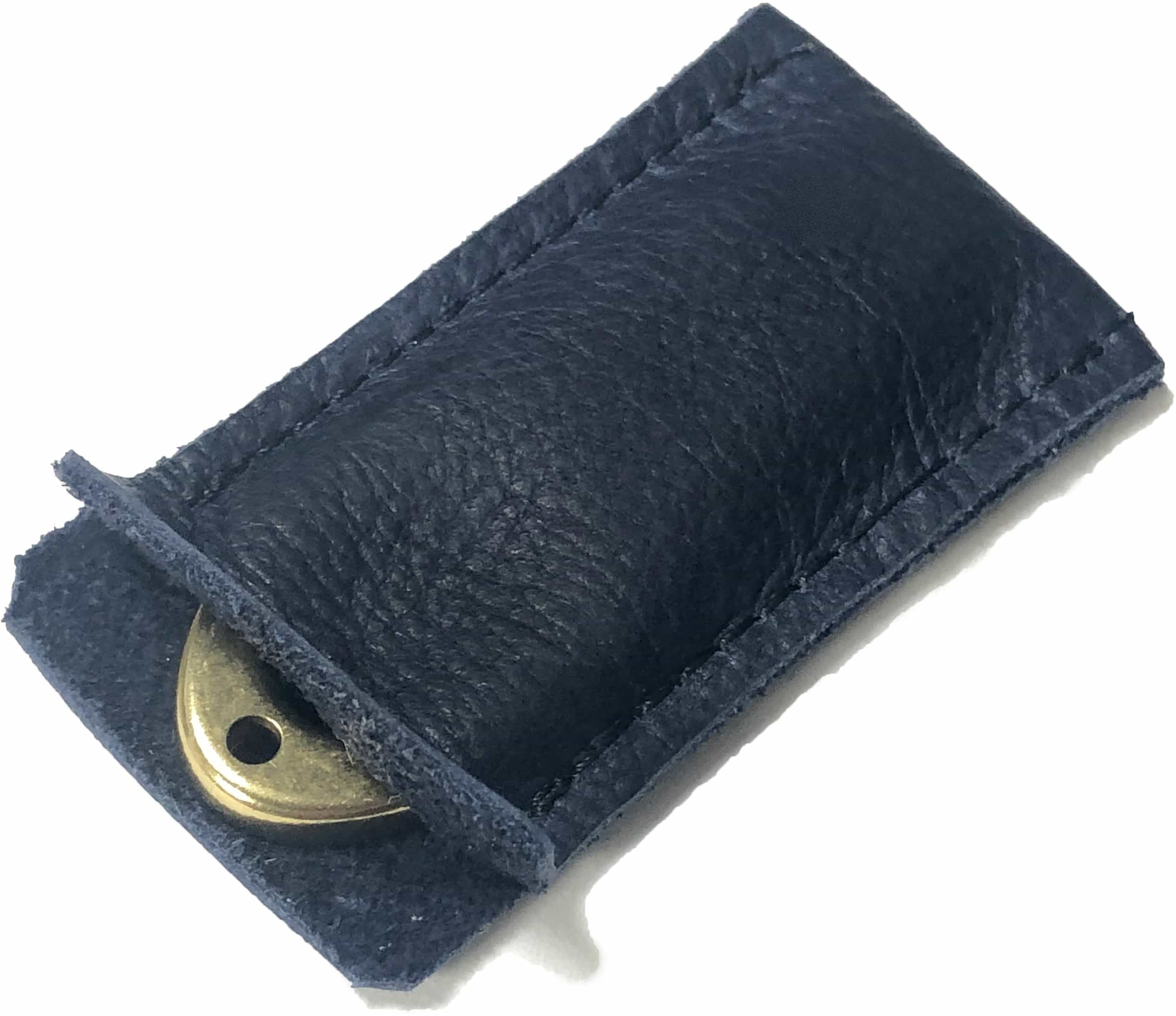 Golf divot tool solid brass with blue aniline leather sleeve, shown inserted.