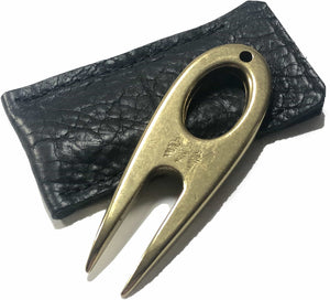 Golf divot tool solid brass with black bison leather sleeve, showing the color.