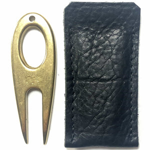 Golf divot tool solid brass with aniline leather sleeve, vertical sleeve side by side.