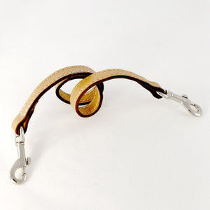 Leather key lanyard in saddle tan coiled
