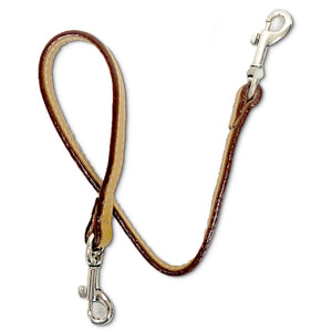 Leather key lanyard in saddle tan on its side to show the edge