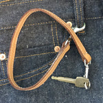 Load image into Gallery viewer, Leather key lanyard in saddle tan attached to Levis belt loop