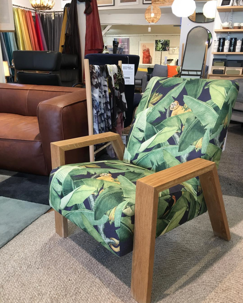 Mogambo Armchair in a tropical print with oak arms