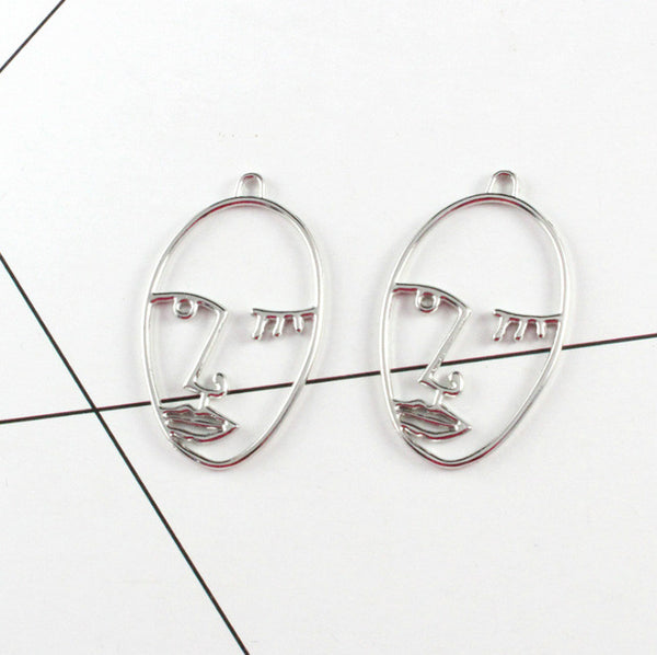 Lance Funny Metal Hollow Face Pendientes de palma Resumen Face Earrings