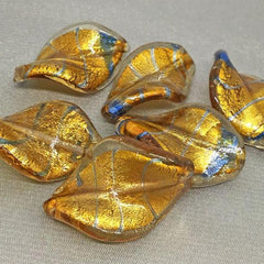 4 Vintage Wavy Gold Metallic Foil Oval Glass Beads