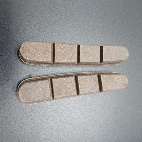 Carbon cork brake pads for carbon fiber rims