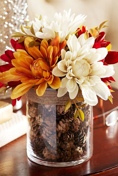 Fall flower and pinecone centerpiece. Fall Decor. Great for Thanksgiving or halloween. Fall DIY. Link found at socialcrafts.com #falldecor #diyfalldecor #thanksgivingdecor #easydiy #thanksgivingdiy  #halloweendecor #halloweendiy #centerpiece #fallcenterpiece #fallflowercenterpiece