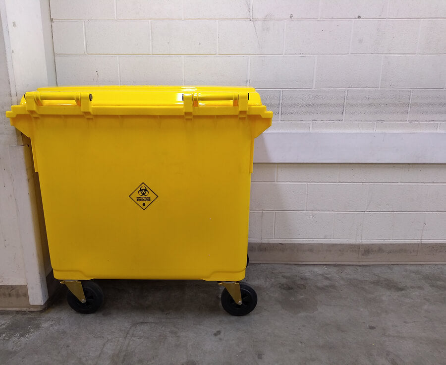 What are yellow bins used for in hospitals?