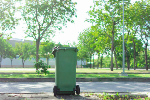 green wheelie bin on street