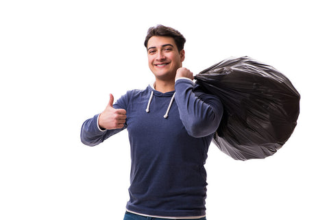 man carrying wheelie bin liner full of waste