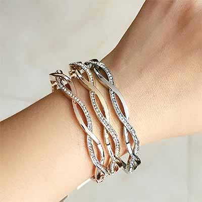 Infinity-Twinkle-Crystal-Bracelet-on-womans-wrist