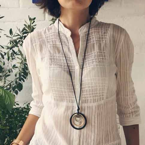 Woman-Wearing-Linen-Shirt-Art-Deco-geometric-necklace-Mayfairtrends