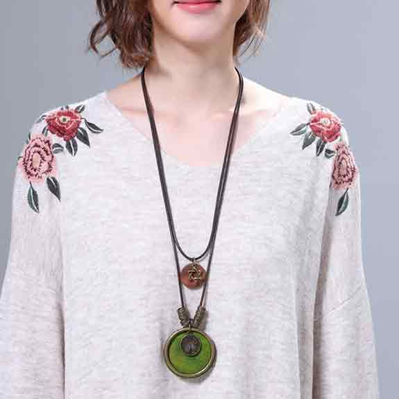 Woman-dressed-gray-jumper-wearing-SABO-Tree-of-Life-Pendant-Mayfairtrends