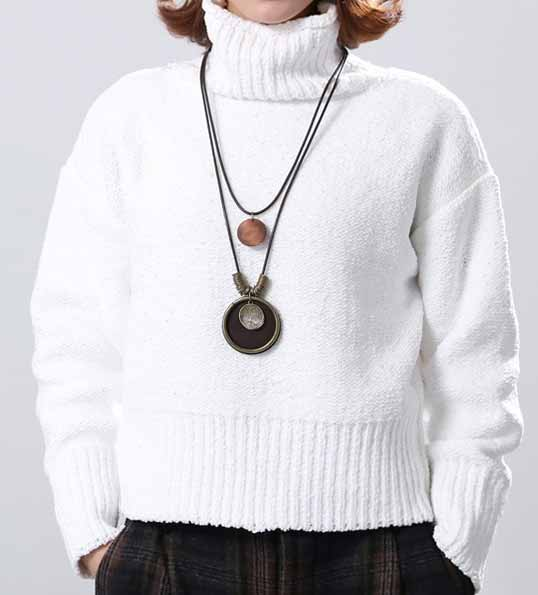 Woman-dressed-white-jumper-wears-SABO-Tree-of Life-Pendant-color-brown-Mayfairtrends