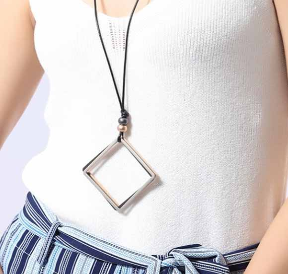 closeup-detailed-view-woman-white-tshire-wearing-Mayfair-Chic-Trio-Square-Necklace