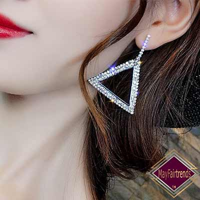 woman-side-view-wearing-Art-Deco-Spark-Plenty-Earrings-color-silver