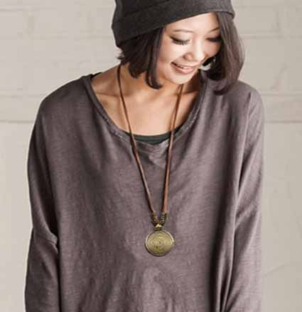 woman-wearing--brown-shirt-wears-Mayfair-Boho-Spiral-Necklace