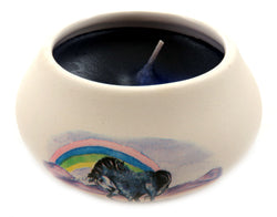 Off white ornamental ceramic candle with a unicorn and rainbow design CNDL12