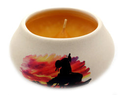 Off white ornamental ceramic candle with an Indian on a horse silhouette design (yellow candle) CNDL13