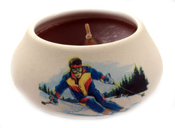 Off white ornamental ceramic candle with a painted design of a skier CNDL17