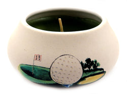 Off white ornamental ceramic candle with a golf ball and course design CNDL18