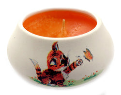 Off white ornamental ceramic candle with a cat swatting a butterfly design CNDL29