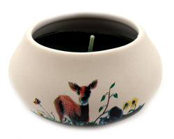 Off white ornamental ceramic candle with a painted design of a deer in a field CNDL30
