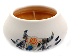 Off white ornamental ceramic candle with a southwestern style motif skull with feathers design (yellow candle) CNDL32