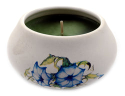 Off white ornamental ceramic candle with a blue flower design CNDL4