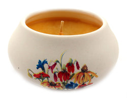 Off white ornamental ceramic candle with an assorted colored flower design CNDL6