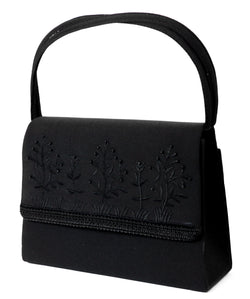 Black Fashion Handbag Purse With Intricate Design and Magnetic Snap Closure PS551
