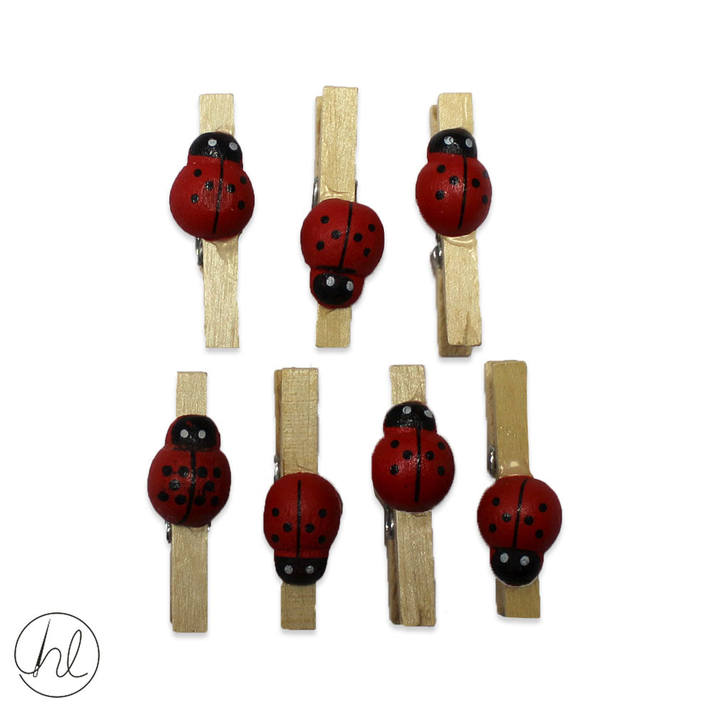 7 WOODEN EMBELLISHMENT LADYBIRDS ON PEGS (CB2911)